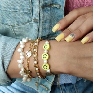 Pulsera cadena de carita feliz y perlas