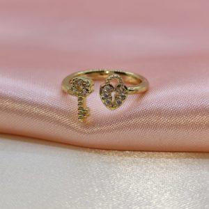 Anillo llave y candado ajustable con baño de oro